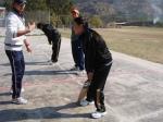 Female teacher learning cricket