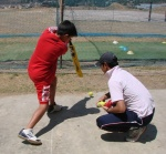 Tobden practicing stationary ball drills